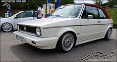 White Mk1 VW Golf Cabriolet with a red hood on BBS split rim wheels at the Wörthersee Tour 2010, via Flickr.