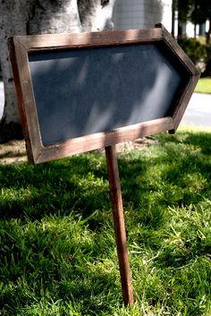 """Double sided 21"""" Wood Framed Blackboard Arrow with Stake $17  31"""" tall.  Stake screws into the frame. Blackboard on both sides.  Can put stake in either end to use facing either way.  Blackboard (including frame measures 11""""x 25"""" long).  Pole(only) 20"""" tall.  Chalk Board (w/o frame) 8"""" x 21.5""""  Rustic wood frame.  Frame is 1"""" wide."""