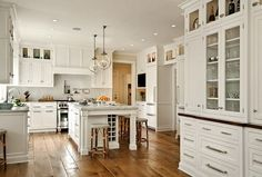 Can lights, pendants, glass cabinets at top (also glass for cabinets by ovens)