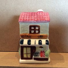 These adorable hand painted, glazed ceramic salt and pepper shaker set consists of 2 pieces which form the VillageShop.  The top portion is the