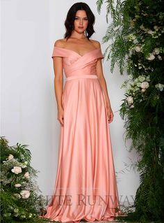 Emmerson Gown. A stunning full length gown by Elle Zeitoune. An off shoulder style with a cinched in waistband and flowy skirt.