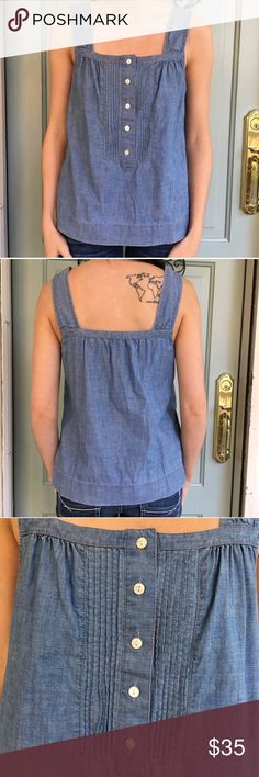 J. Crew Blue Jean Sleeveless Button Up Tank Top J. Crew Blue Jean Sleeveless Button Up Tank Top. Flawless condition. Adorable on and so comfy. Great addition to every spring wardrobe. Great for layering or wearing alone. J. Crew Tops Blouses