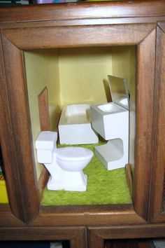 DOLL HOUSE CREATED FROM CHEST OF DRAWERS