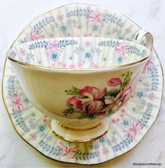 Charming Queen Anne 'Royal Bridal Gown' embroidered tea cup and saucer featuring pretty pink bows and leafy floral details. Set is in nice antique condition with no chips or cracks, the set does have some crazing but it's very minor.