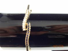 Gold Pre Loved 9ct Yellow Gold 61.7mm 11Cubic Zirconia & 11Sapphire Clip Bangle | eBay