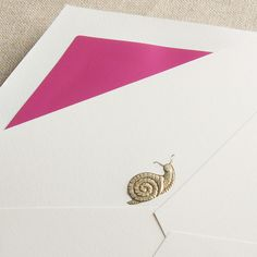 Engraved Garden Snail Note: Slow and steady wins our affections every time, be it a handwritten note in our postbox or this engraved garden snail in elegant gold. Paired with our raspberry envelope lining for a perfect pop of color.
