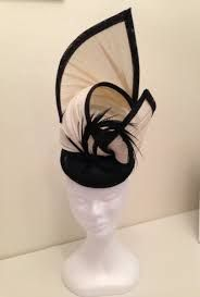 Dramatic jinsin and black sinamay hat by Lucy Hoolihan. 118ae85960f