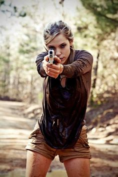 Devon usually fights with her knives, but she's pretty badass with a gun, too.