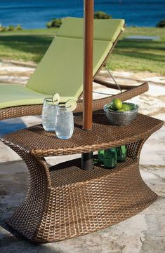 The artfully woven Balencia Bronze Umbrella Table is a beautiful accompaniment to our Balencia chaise lounges. This convenient table is perfect for holding drinks and snacks.