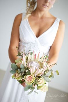pretty dress and protea bouquet