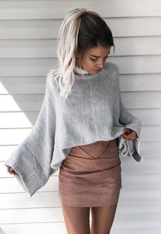 baggy grey sweater with nude mini skirt is a vinning combo