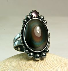 Statement Ring, Rainbow Obsidian Stone, Renaissance Ring, Black Silver, Amethyst Gemstone, Sterling Silver by TazziesCustomJewelry on Etsy https://www.etsy.com/listing/200106907/statement-ring-rainbow-obsidian-stone