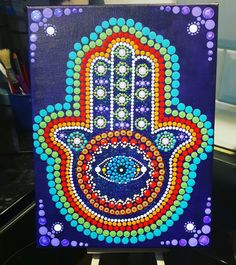 "Hamsa hand 9"" x 12"" canvas on a deep purple background by Suzanne Cannon."