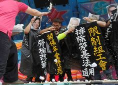 May Day around the world  -  May 1, 2017:      Taiwanese workers throw bean curd to performers acting Taiwanese president Tsai Ing-wen and other officeholders during a Labor Day rally in Taipei, Taiwan, on May 1, 2017.