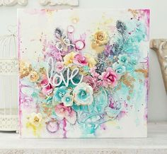 """""""I just fell in love with this month's Prima Product Pick the minute I saw it!!  The colours are so fun, fresh, and bright, right up my alley.  I created a canvas piece on a Prima Watercolor Panel.  I just love the way all of the mixed-media products worked on this panel.   I started out with the idea of a birdcage (bottom right-hand side) and then the project progressed from there and, of course, I had to layer loads of beautiful Prima flowers."""" ~ Stacey Young #PPP #colorpalette #spring…"""