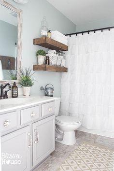 Modern Farmhouse Bathroom Makeover   Bless'er House - So many great ideas to create charm in a builder grade bathroom!