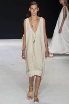 The other main story was were the breezy loose tunic dresses that were often sheer. They were desert-chic long dresses in all white.   - HarpersBAZAAR.com