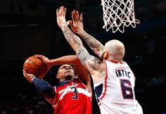 Pero Antic Photos Photos - Pero Antic #6 of the Atlanta Hawks defends against Bradley Beal #3 of the Washington Wizards during Game One of the Eastern Conference Semifinals of the 2015 NBA Playoffs at Philips Arena on May 3, 2015 in Atlanta, Georgia.  NOTE TO USER: User expressly acknowledges and agrees that, by downloading and/or using this photograph, user is consenting to the terms and conditions of the Getty Images License Agreement. - Washington Wizards v Atlanta Hawks - Game One