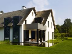 Beautiful contemporary take on a traditional villa by Dutch architect Bob Manders.