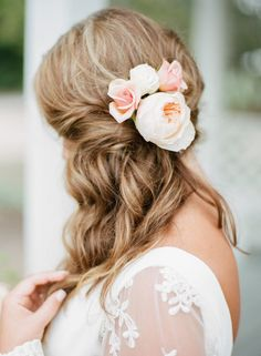 Soft curls and fresh florals pair for the perfect romantic look! See more from MC and Josh's destination wedding on the Brides of Oklahoma Blog! #bridesofok #bridal #hair #floral #wedding