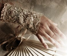 elegant and delicate, lavishly hand embroidered and beaded cuff. Made from fine linen and vintage laces.