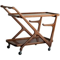 1950's tea trolley in walnut designed by Cesare Lacca for Cassina   From a unique collection of antique and modern bar carts at http://www.1stdibs.com/furniture/tables/bar-carts/
