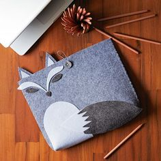 FELT FOX LAPTOP HOLDER from West Elm. Cute, but seems like it's just for show rather than being very functional.