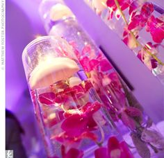 Not so bright of colors but love how they are submerged - not as centerpieces but possibly other parts of the wedding
