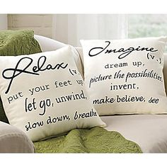I think this could easily be done with a stencil/ black paint/ and some hand sewn envelope pillow cases!