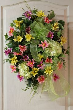 4) Spring wreath - Beautiful Hydrangeas and multi colored Daisies along with two lime green bows makes this a Spring wreath that will surely brighten your front door!