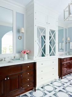 Bathroom. Blue Bathroom with white cabinet. Bathroom with blue walls and white cabinet. Bathroom sconces are the Vendome Single Sconce. #Bathroom #BlueBathroom #BathroomWhiteCabinet #VendomeSconce  Andrew Howard Interior Design.