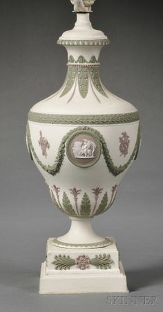 Wedgwood Three-color Jasper Lamp Base, England, c. 1900, solid white ground with lilac, white, and green relief of classical medallions below floral festoons with trophies and assorted foliate borders.