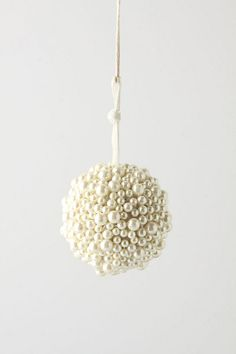 Pearly Expanse Ornament $12 at anthropologie but super easy to replicate with a styrofoam ball and a packet of plastic pearl-headed pins...