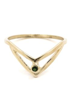 The Mercy is a ring fit for royalty. The unique shape is like a little crown for your finger and the finishing touch is a deep emerald stone. Details: 14k solid gold. Emerald. Rho & Jo is modern fine