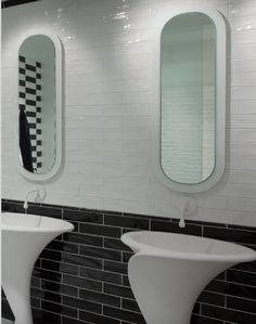 Black and white glossy subway tile in this modern bathroom