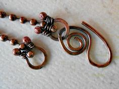 Earlier this week on Facebook, a dear friend and fellow artist, Carol Myers, asked if anyone knew of a tutorial to make wire loops for the end of ball chain. After several folks chimed in and googled
