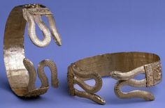 Pair of Gold Bracelets, Sicily, 330-300 BC    Gold bands terminating at each end in two snake heads, each made from one sheet of gold. Part of the Avola Hoard, found with 300 4th century BC coins from Syracuse and Persia.