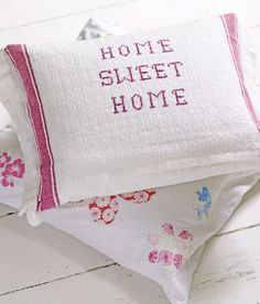 ~ very homey feel with lots of white + soft colours and floral patterns tea towel pillows // deco // cath kidston