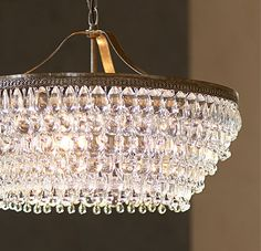 Chandelier Tips to Get Light Right  hang it right For the standard 8-foot ceiling, hang your chandelier so that the bottom of the fixture falls 30 to 34 inches above your dining table. Add the length and width of your room in feet, then use the same number, but in inches, to determine the best size chandelier diameter for your space.