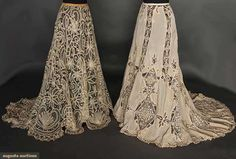 TWO BELLE EPOQUE LACE SKIRTS, circa 1905. Both beige w/trains: 1 silk w/torchon and tape lace insertions; 1 Battenburg lace w/blossom and fan motifs.