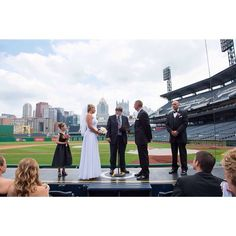 #pncparkwedding I absolutely loved being able to stand on the dugout for pictures after this beautiful ceremony!! #pittsburghweddings #pittsburghweddingphotographer #krystalhealyphotography