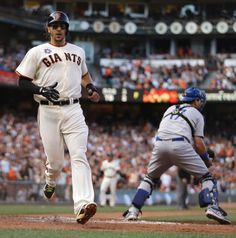 San Francisco Giants' Michael Morse, left, scores behind Los Angeles Dodgers catcher A.J. Ellis in the fourth inning of a baseball game Sunday, July 27, 2014, in San Francisco. Morse scored on a single by Brandon Crawford. (AP Photo/Ben Margot)
