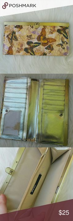 Urban outfitters gold butterfly wallet Great condition, has quite a few scuffs on the exterior near the bottom (hardly noticeable) and the interior shows some minor signs of use. Urban Outfitters Bags Wallets