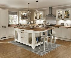 The Burford Tongue & Groove shaker style kitchen in Ivory. Traditional and warm with a beautiful wooden worktop. The Kitchen island privides additional storage, worksurface and dining area. Take a look at Howdens for kitchen ideas and inspiration.