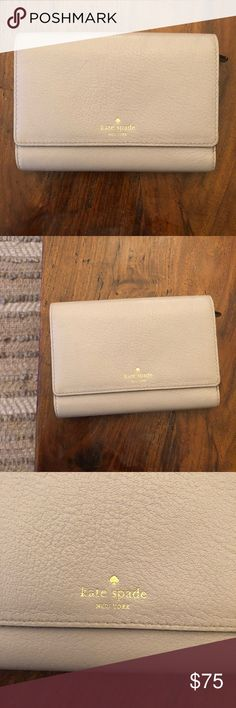 Kate Spade Wallet A medium size wallet and seriously so cute for every day. It's pebbled in color almost like a pale purple/ grey. I have used it maybe for a week. I seriously just have too much and need to clean out. There is a small ink spot on the back.. it's literally barely there but wanted to point out. Please ask any questions. kate spade Bags Wallets