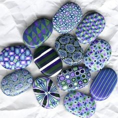 painted stones rocks. LOVE!  LOVE!  LOVE!.....since I have a porch filled with smooth rocks!!