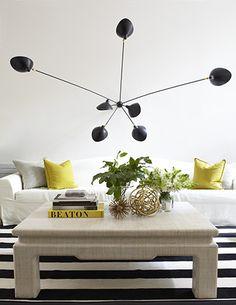 Pamplemousse Design - living rooms - black and yellow living room, black and white striped rug, striped rug, black and white rug, square coffee table, contemporary light pendant, slipcovered sofa, white sofa, white slipcovered sofa, yellow and gray pillows,