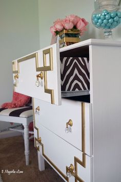 IKEA Tarva dresser is hacked to a glamorous gloss white dresser with a DIY gold greek key overlay. Step by step tutorial.: