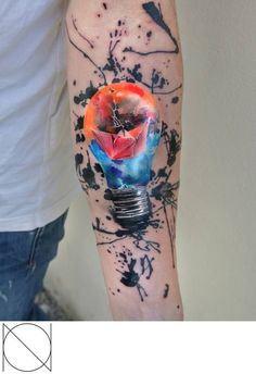 This is one of Aria's favorite watercolor tattoos... The lightbulb looks like it's popping off the skin!