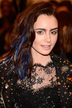 Lily Collins May 2013 Obviously the theme of 2013's Met Gala was punk, so Lily's beauty team gave her a wild look inspired by Siouxsie Sioux. She added a few cobalt streaks to her hair to really live in the moment.